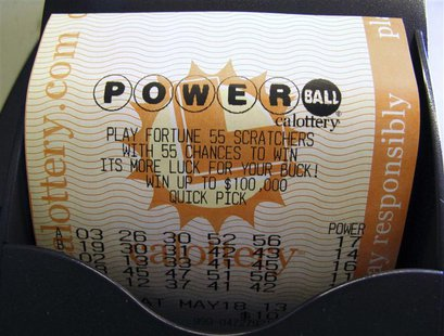 A Powerball lottery ticket is printed out of a lottery machine after purchase at a convenience store in Encinitas, California in this file p