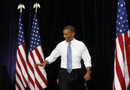 U.S. President Barack Obama walks out to speak about home ownership at Desert Vista High School in Phoenix, Arizona August 6, 2013. REUTERS/