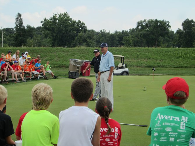 Peter Senior and Morris Hatalzky holding court at the Kids golf clinic.  It's all about the short game.