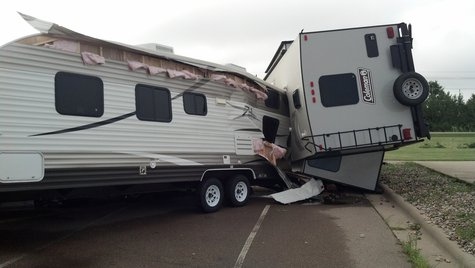 Storm damages vehicles in the parking lot of Quality RV in Kaukauna on August 7, 2013. (Photo by: Jeff Flynt).