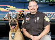 Baco and Deputy Dan Wachowiak from the Portage County Sheriff's Department