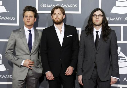 Rock band Kings of Leon pose on arrival at the 53rd annual Grammy Awards in Los Angeles, California February 13, 2011. REUTERS/Danny Molosho