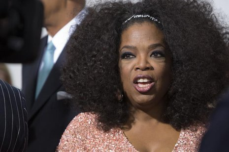 Cast member Oprah Winfrey attends director Lee Daniels' 'The Butler' New York film premiere at the Ziegfeld Theater in New York August 5, 20