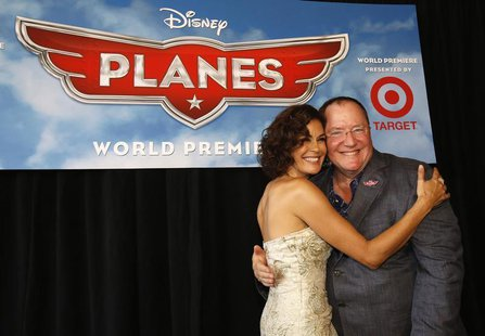 John Lasseter (R), Chief Creative Officer at Pixar and Walt Disney animation studios, poses with actress Teri Hatcher, who voices the charac