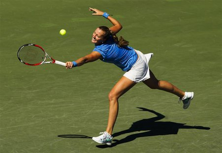 Petra Kvitova of the Czech Republic returns a shot to Sorana Cirstea of Romania during their women's quarter-finals tennis match of the Roge