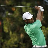 Tiger Woods of the U.S. tees off on the 12th hole during the second round of the 2013 PGA Championship golf tournament at Oak Hill Country C