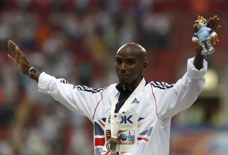 Gold medallist Mo Farah of Britian poses during the men's 10,000 metres victory ceremony at the IAAF World Athletics Championships at the Lu