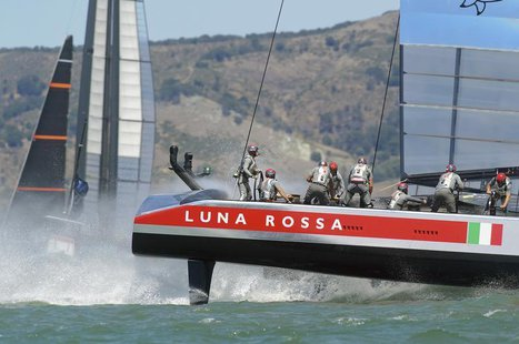 Italy's Luna Rossa Challenge (R) passes Sweden's Artemis Racing during Race 4 of their Louis Vuitton Cup semi-finals in San Francisco, Calif