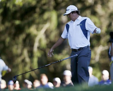 Jason Dufner of the U.S. drops his club after his tee shot on the 18th hole during the third round of the 2013 PGA Championship golf tournam