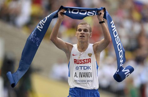 Aleksandr Ivanov of Russia celebrates winning the men's 20 km race walk final during the IAAF World Athletics Championships at the Luzhniki