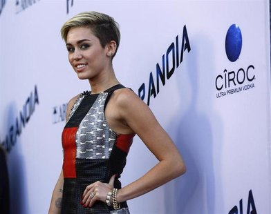 "Singer Miley Cyrus poses at the premiere of ""Paranoia"" in Los Angeles, California August 8, 2013. The movie opens in the U.S. on August 16."