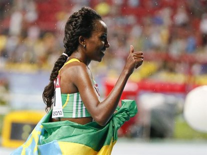 Tirunesh Dibaba of Ethiopia celebrates her victory in the women's 10,000 metres final during the IAAF World Athletics Championships at the L