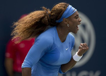 Serena Williams of the U.S. reacts against Sorana Cirstea of Romania during their women's final tennis match of the Rogers Cup tennis tourna