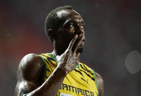 Usain Bolt of Jamaica celebrates winning in the men's 100 metres final during the IAAF World Athletics Championships at the Luzhniki stadium