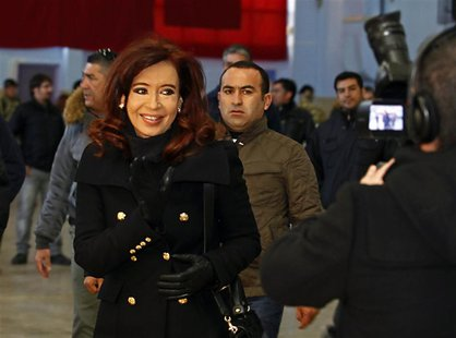 Argentine President Cristina Fernandez leaves after casting her vote at a polling station in the Patagonian city of Rio Gallegos August 11,