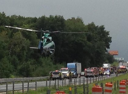 Air Ambulance arrives to carry most seriously injured to emergency.
