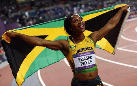 Jamaica's Shelly-Anne Fraser-Price celebrates her second place finish in the women's 200m final during the London 2012 Olympic Games at the