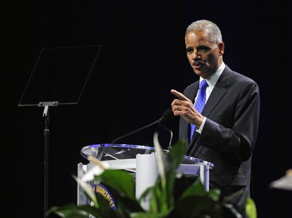 U.S. Attorney General Eric Holder speaks at the annual convention of the National Association for the Advancement of Colored People (NAACP)