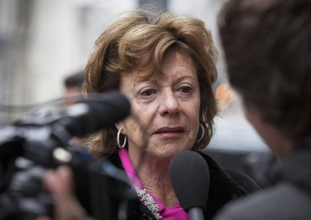 Neelie Kroes, european commissioner for digital technology, arrives at a meeting for European Liberal politicians in Amsterdam February 25,