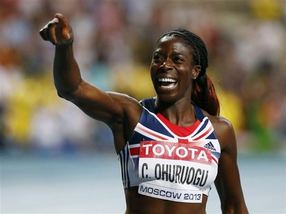 Christine Ohuruogu of Britain celebrates winning the women's 400 metres final during the IAAF World Athletics Championships at the Luzhniki