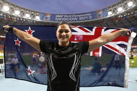 Valerie Adams of New Zealand celebrates with her national flag after winning the women's shot put final during the IAAF World Athletics Cham