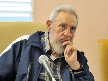 Former Cuban leader Fidel Castro sits at the inauguration of the Vilma Espin Guillois school in Havana in this picture taken on April 9, 201