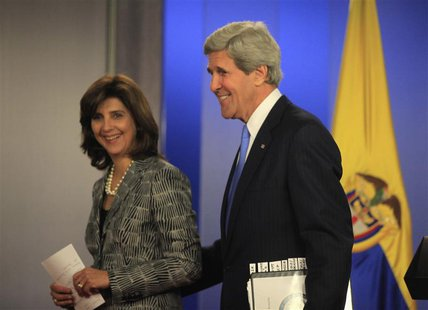U.S. Secretary of State John Kerry smiles with Colombia's Foreign Minister Maria Angela Holguin after a news conference at the presidential