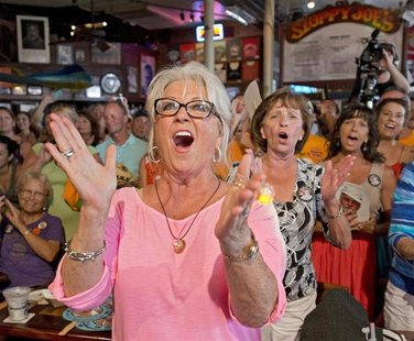 "Food Network television personality Paula Deen cheers for her husband Michael Groover during the semi-finals of the ""Papa"" Hemingway Look-Al"