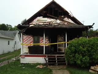 House at 705 Dodge Street in Kaukauna damaged by fire on August 11, 2013. (Photo by: FOX 11).