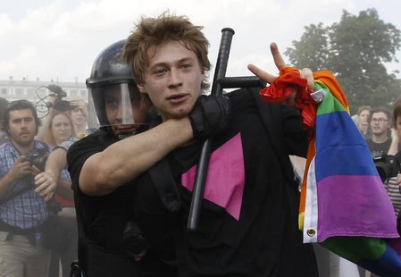 Police detain a gay rights activist during a Gay Pride event in St. Petersburg, June 29, 2013. REUTERS/Alexander Demianchuk