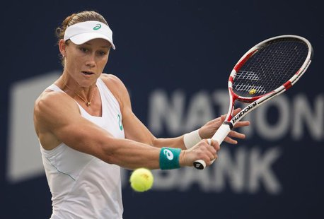 Samantha Stosur of Australia hits a return to Petra Kvitova of the Czech Republic during their women's tennis match at the Rogers Cup tennis