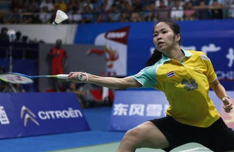 Thailand's Ratchanok Intanon hits a return to China's Li Xuerui during their women's singles final match at the 2013 Badminton World Champio