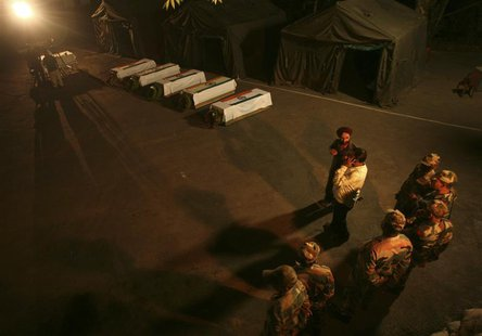 Indian army soldiers stand near the coffins of colleagues during a wreath laying ceremony in Poonch district, northwest of Jammu in this Aug