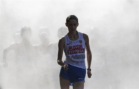 Elena Lashmanova of Russia comes out of the cooling mist in the women's 20 km race walk final during the IAAF World Athletics Championships