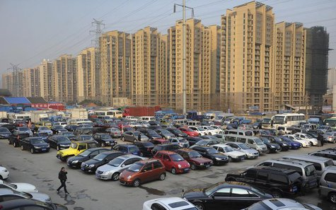 Car dealers and customers walk at a second-hand car market near a newly-built residential area in Hefei, Anhui province, January 26, 2013. R