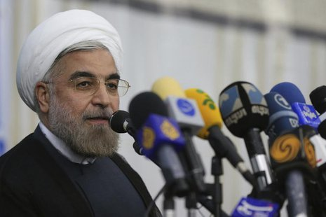 Iranian President Hassan Rouhani speaks to the media following a visit to the Khomeini mausoleum in Tehran June 16, 2013. Reuters/Fars News/