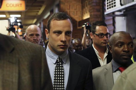 Oscar Pistorius leaves after court proceedings at the Pretoria Magistrates court June 4, 2013. REUTERS/Siphiwe Sibeko