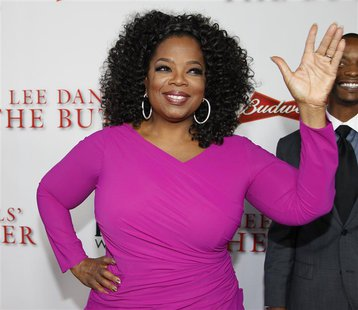 "Actress Oprah Winfrey, a cast member of the film ""Lee Daniels' The Butler"", poses at the film's premiere in Los Angeles August 12, 2013. REU"