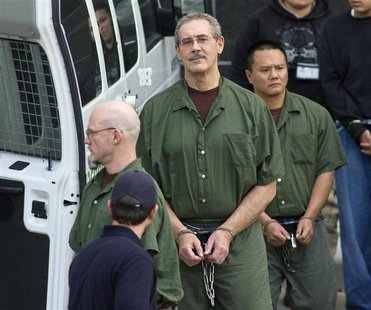 Allen Stanford (C) leaves the Federal Courthouse where the jury found him guilty, in Houston in this file photo from March 6, 2012. REUTERS/