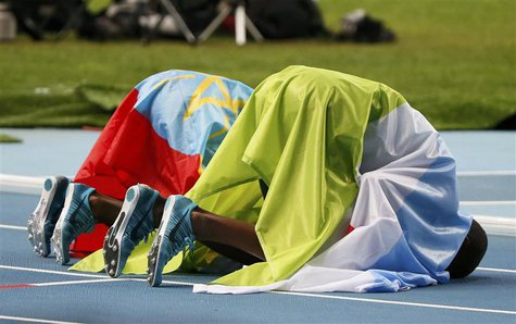 Winner Mohammed Aman (L) of Ethiopia and third placed Ayanleh Souleiman of Djibouti bow after the men's 800 metres final of the IAAF World A