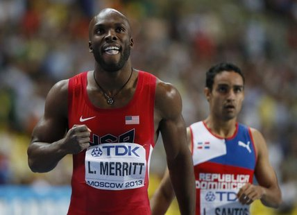 LaShawn Merritt (L) of the U.S. reacts next to third placed Luguelin Santos of Dominican Republic after winning the men's 400 metres final o