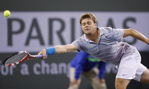 Ryan Harrison of the U.S. misses a shot against Rafael Nadal of Spain during their match at the BNP Paribas Open ATP tennis tournament in In