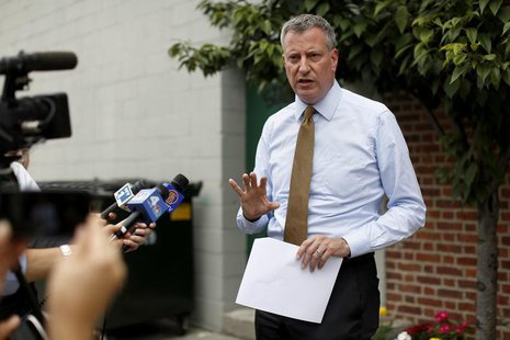 New York City mayoral candidate, Public Advocate Bill de Blasio, talks to the media during a campaign stop in the Brooklyn borough of New Yo