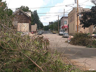 Brush from storms six days earlier lines streets in Hortonville, Aug. 13, 2013. (Photo courtesy of Fox 11 WLUK-TV)
