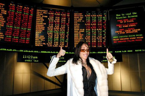 Hollywood Madam Heidi Fleiss poses for photographers at the Australian Stock Exchange in Melbourne May 1, 2003 after the brothel known as 'T