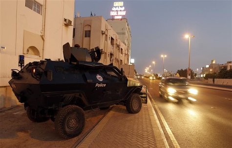 An armoured personnel carrier is seen by the side of a road during the early hours of the evening in Manama August 13, 2013. REUTERS/Hamad I