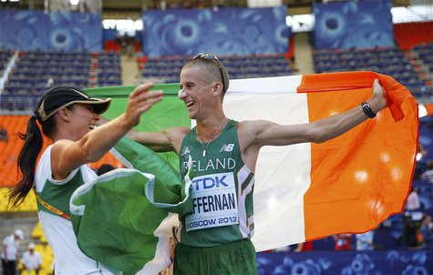 Robert Heffernan of Ireland celebrates winning the men's 50 km race walk final with his wife Marian during the IAAF World Athletics Champion