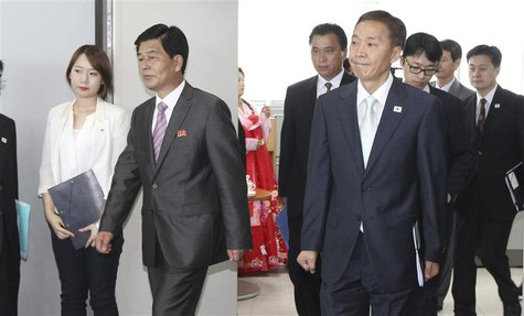 Head of the South Korean working-level delegation Kim Ki-woong (front R) and his North Korean counterpart Park Chol-su (2nd L) arrive for th