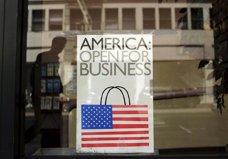 A sign is shown in the window of a retail store in San Francisco, California in this file photo taken May 13, 2013. REUTERS/Robert Galbraith