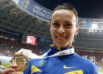Gold medallist Ganna Melnichenko of Ukraine shows her medal at the women's heptathlon victory ceremony during the IAAF World Athletics Champ